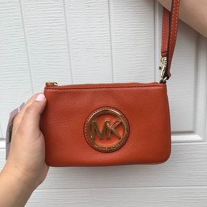 MICHAEL Michael Kors Fulton Wristlet Burnt Orange